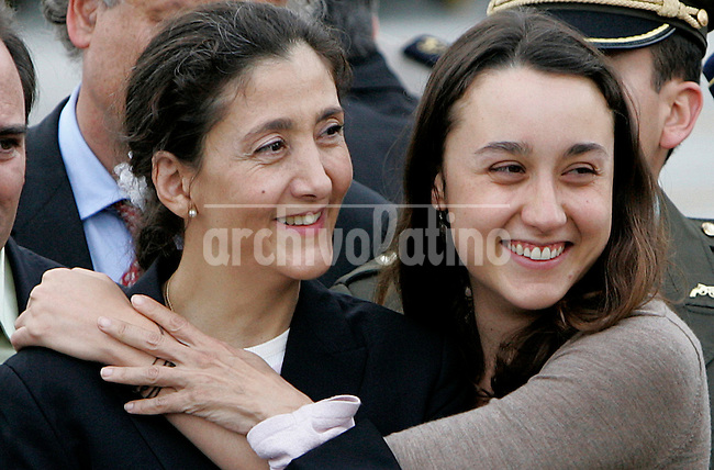 Former hostage Ingrid Betancourt embraces her  daughter Melanie upon their arrival from France at a military base in Bogota, Thursday, July 3, 2008. Betancourt embraced her children for the first time in six years