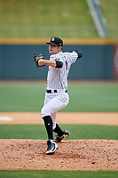 Birmingham Barons relief pitcher Connor Walsh (9) delivers a pitch during a game against the Pensacola Blue Wahoos on May 9, 2018 at Regions FIeld in Birmingham, Alabama.  Birmingham defeated Pensacola 16-3.  (Mike Janes/Four Seam Images)