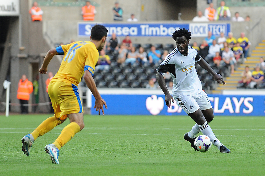 Swansea City's Wilfried Bony in action during todays match  <br /> <br /> (Photo by Ian Cook/CameraSport)<br /> <br /> Football - UEFA Europa League Qualifying Play-off First leg - Swansea City v Petrolul Ploiesti - Thursday 22nd August 2013 - The Liberty Stadium - Swansea<br /> <br /> &copy; CameraSport - 43 Linden Ave. Countesthorpe. Leicester. England. LE8 5PG - Tel: +44 (0) 116 277 4147 - admin@camerasport.com - www.camerasport.com