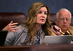 Nevada Assemblywoman Melissa Woodbury, R-Las Veags, works in committee at the Legislative Building in Carson City, Nev., on Wednesday, Feb. 25, 2015. Assemblyman Lynn Stewart, R-Henderson, is at right.  <br /> Photo by Cathleen Allison