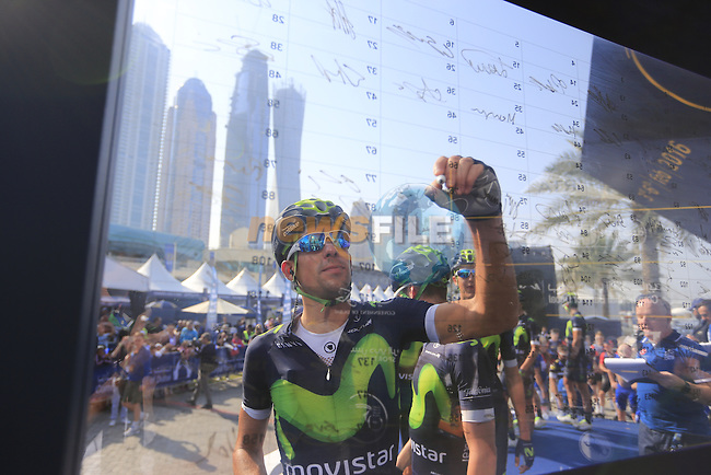 Movistar Team sign on before the start of Stage 2, the Nakheel Stage, of the 2016 Dubai Tour starting at the Dubai International Marine Club and running 188km to Palm Jumeirah Atlantis, Dubai, United Arab Emirates. 4th February 2016.<br /> Picture: Eoin Clarke | Newsfile<br /> <br /> <br /> All photos usage must carry mandatory copyright credit (&copy; Newsfile | Eoin Clarke)