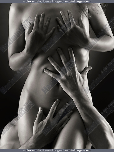 Man hands holding beautiful nude woman body, artistic nude black and white