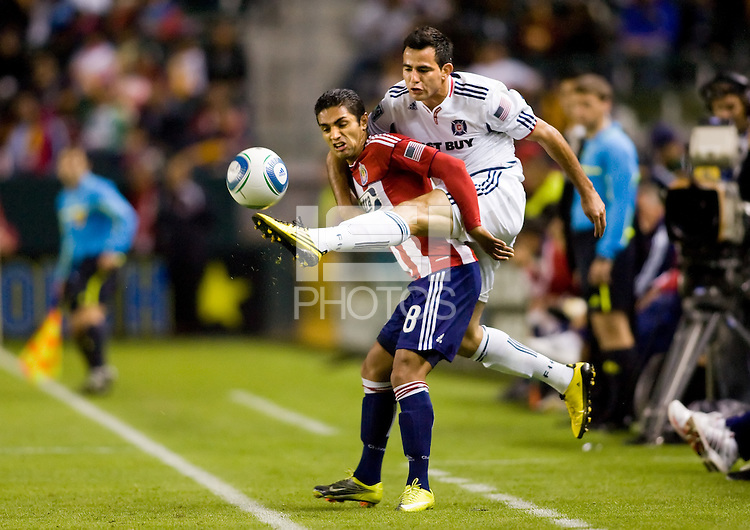 Chivas USA defender Mariano Trujillo and Chicago Fire midfielder Marco Pappa battle for a loose ball. The Chicago Fire defeated CD Chivas USA 3-1 at Home Depot Center stadium in Carson, California on Saturday October 23, 2010.