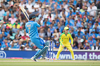MS Dhoni (India) pulls Marcus Stones (Australia) bacbackward of square for four during India vs Australia, ICC World Cup Cricket at The Oval on 9th June 2019