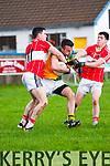 Castlegregory Gavin O'Connor tackled by Daingean Uí Chúis Micheal Ó Geibheannaigh and Micheal Ó Flannabhra during the West Kerry Semi-Final at Annascaul GAA Grounds on Saturday afternoon.