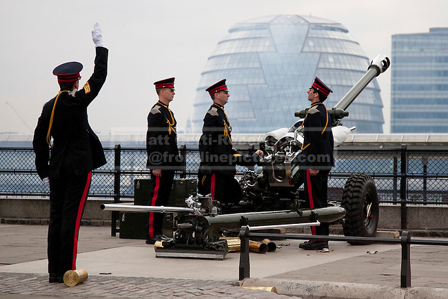 LONDON, UK  02/06/11. A gun crew of the Honourable Artillery Company (HAC) prepares to fire part of a 62 gun salute at the Tower of London to mark the anniversary of the Queen's ascension to the throne in 1953. Photo credit should read Matt Cetti-Roberts