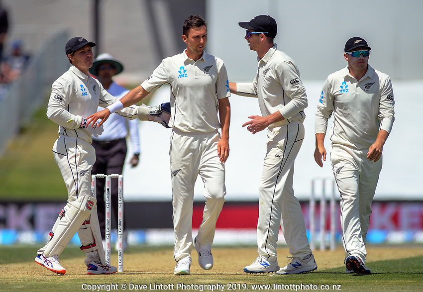 NZ's Trent Boult celebrates dismissing England's Jofra Archer during day two of the international cricket 1st test match between NZ Black Caps and England at Bay Oval in Mount Maunganui, New Zealand on Friday, 22 November 2019. Photo: Dave Lintott / lintottphoto.co.nz