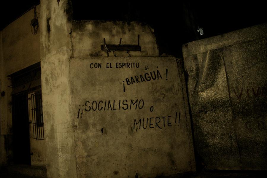 "Havana (Cuba). September 2006..La Habana Vieja. Graffiti ""Socialism or death""."