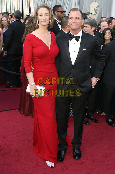 Janet McTeer & guest.84th Annual Academy Awards held at the Hollywood & Highland Center, Hollywood, California, USA..February 26th, 2012.oscars full length red dress black tuxedo  .CAP/ADM.©AdMedia/Capital Pictures.