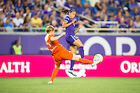 Orlando, Florida - Saturday, April 23, 2016: Houston Dash defender Rebecca Moros (4) clears the ball while pressured by Orlando Pride defender Kristen Edmonds (12) during an NWSL match between Orlando Pride and Houston Dash at the Orlando Citrus Bowl.