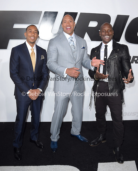 Chris Ludacris Bridges ,Dwayne Johnson and Tyrese Gibson attends The Universal Pictures World Premiere of Furious 7 held at The TCL Chinese Theatre IMAX Theater  in Hollywood, California on April 01,2015                                                                               © 2015 Hollywood Press Agency