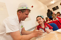 ASDA Newark baker Mark Smith shows Rainbow Megan Horbury, 6, how to knead dough
