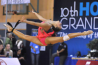 Daria Dmitrieva of Russia performs handsfree (split leap) in gala exhibition at Holon Grand Prix, Israel on March 5, 2011.  (Photo by Tom Theobald).