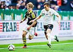 Solna 2015-04-26 Fotboll Allsvenskan AIK - &Ouml;rebro SK :  <br /> AIK:s Sam Lundholm i kamp om bollen med &Ouml;rebros Logi Valgardsson under matchen mellan AIK och &Ouml;rebro SK <br /> (Foto: Kenta J&ouml;nsson) Nyckelord:  AIK Gnaget Friends Arena Allsvenskan &Ouml;rebro &Ouml;SK