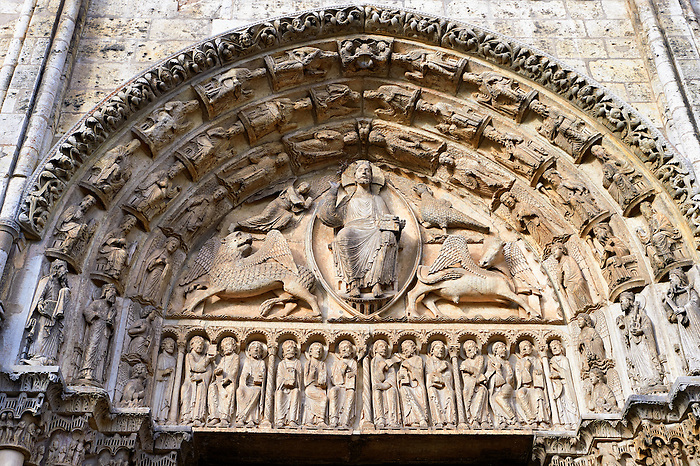 West Facade, Central Portal Tympanum - General View c. 1145. Cathedral of Chartres, France . The tympanum shows gothic sculptures of Christ in Majesty surrounded by the four Evangelist Symbols. The inner archivolt contains angels. On the two outer archivolts are the twenty-four elders of the Apocalypse. On the lintel are the twelve Apostles flanked by two other figures holding scrolls (Elisha and Enoch?). A UNESCO World Heritage Site. .