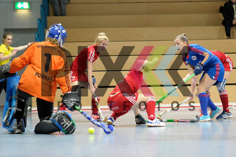 GER - Mannheim, Germany, December 19: During the 1. Bundesliga Sued Damen indoor hockey match between Mannheimer HC (blue) and Nuernberger HTC (red) on December 19, 2015 at Irma-Roechling-Halle in Mannheim, Germany.  (L-R) Pauline Kosmann #1 of Nuernberger HTC, Julie Bruegel #16 of Nuernberger HTC, Nina Meller #22 of Nuernberger HTC, Nadine Kanler #4 of Mannheimer HC<br /> <br /> Foto &copy; PIX-Sportfotos *** Foto ist honorarpflichtig! *** Auf Anfrage in hoeherer Qualitaet/Aufloesung. Belegexemplar erbeten. Veroeffentlichung ausschliesslich fuer journalistisch-publizistische Zwecke. For editorial use only.
