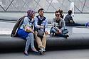 Paris, France. 09.05.2015. Tourists posing for a selfie photo outside Le Louvre. Photograph © jane Hobson.