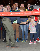19 April 2017 - Prince Harry is helped by Melissa Howse to officially open the Virgin Money London Marathon Expo at ExCel in London. Prince Harry, who is Patron of the London Marathon Charitable Trust, will meet runners and hand out race numbers, along with special edition Heads Together headbands, which is the official Charity of the Year for this year's marathon. Photo Credit: ALPR/AdMedia