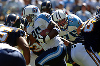 Sept. 17, 2006; San Diego, CA, USA; Tennessee Titans running back (25) LenDale White rushes the ball against the San Diego Chargers at Qualcomm Stadium in San Diego, CA. Mandatory Credit: Mark J. Rebilas