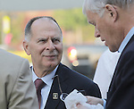 Congressman Bill Enyart (left) listens to Illinois State Senator Bill Haine as the two chatted before the formal start of the rally for Enyart, held Wednesday morning near the Veteran's Memorial at Belleville's Public Square Haine spoke first, and backgrounded Enyart's military career.