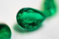 A fine teardrop-shaped emerald, having a value of $5,000-10,000, is seen in the jewelry workshop in Bogota, Colombia, 8 February 2014. Around 60% of the world's emerald production come from Colombia. Most of the gemstones are cut, faceted and processed into jewelry in the workshops located in the emerald district in downtown Bogota. There are approximately 2000 jewelers working in the emerald district. Due to their special clarity and deep vivid green color, Colombian emeralds are considered the most beautiful in the world.