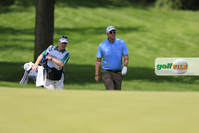 Peter Hanson (SWE) and caddy Mark Sherwood at the 1st green during Saturday's Round 3 of the 2013 Bridgestone Invitational WGC tournament held at the Firestone Country Club, Akron, Ohio. 3rd August 2013.<br /> Picture: Eoin Clarke www.golffile.ie