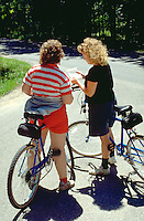 Aunt and niece age 49 and 26 checking map on family bike trip.  Door County  Wisconsin USA