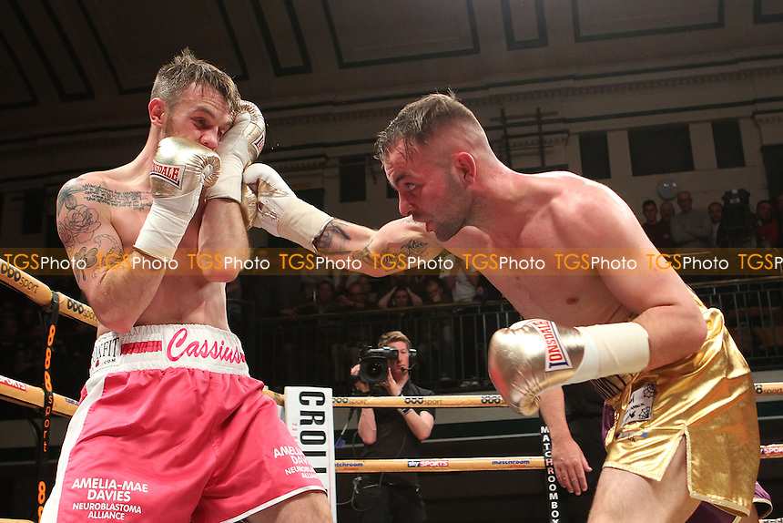Michael Devine (gold shorts) defeats Cassius Connor in a Prizefighter The Lightweights boxing QF contest, promoted by Matchroom Sports - 06/12/14 - MANDATORY CREDIT: Gavin Ellis/TGSPHOTO - Self billing applies where appropriate - contact@tgsphoto.co.uk - NO UNPAID USE