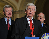 Washington, DC - December 24, 2009 -- United States Senator Christopher Dodd (Democrat of Connecticut) makes remarks after voting to pass H.R. 3590, regarding health care reform in the U.S. Capitol on Thursday, December 24, 2009.  The vote, which was along party lines, was 60 Democrats in favor and 39 Republicans against.  From left to right: U.S. Senator Max Baucus (Democrat of Montana), Senator Dodd, and U.S. Senator Dick Durbin (Democrat of Illinois)..Credit: Ron Sachs / CNP.(RESTRICTION: NO New York or New Jersey Newspapers or newspapers within a 75 mile radius of New York City)