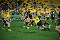 Hurricanes' Jeff Toomaga-Allen tackles Anton Lienert-Brown during the Super Rugby quarterfinal match between the Hurricanes and Chiefs at Westpac Stadium in Wellington, New Zealand on Friday, 20 July 2018. Photo: Dave Lintott / lintottphoto.co.nz