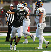 Nick Seidel (18), West Bloomfield, celebrates after a first half interception during varsity football action against Clarkston at West Bloomfield High School Friday, Sept. 15, 2017. West Bloomfield dominated the Wolves throughout for a 37-15 victory. Noah Nicklin (51), Clarkston is also pictured. Photos: Larry McKee, L McKee Photography. PLEASE NOTE: ALL PHOTOS ARE CUSTOM CROPPED. BEFORE PURCHASING AN IMAGE, PLEASE CHOOSE PROPER PRINT FORMAT TO BEST FIT IMAGE DIMENSIONS. L McKee Photography, Clarkston, Michigan. L McKee Photography, Specializing in Action Sports, Senior Portrait and Multi-Media Photography. Other L McKee Photography services include business profile, commercial, event, editorial, newspaper and magazine photography. Oakland Press Photographer. North Oakland Sports Chief Photographer. L McKee Photography, serving Oakland County, Genesee County, Livingston County and Wayne County, Michigan. L McKee Photography, specializing in high school varsity action sports and senior portrait photography.