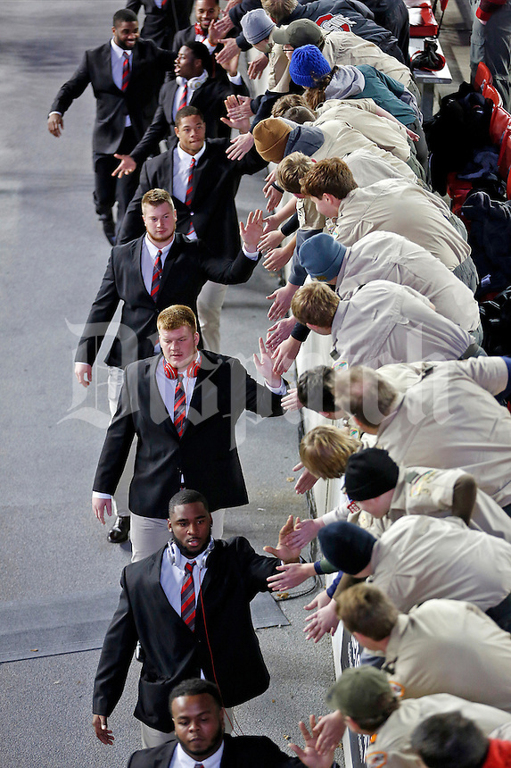 Ohio State football players greet fans upon enter the stadium for Saturday's NCAA Division I football game against the Minnesota Golden Gophers at Ohio Stadium in Columbus on November 7, 2015. (Dispatch Photo by Barbara J. Perenic)