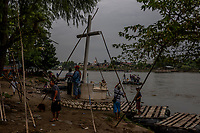 TECUN UMAN, GUATEMALA - OCTOBER 16: Boat drivers wait for customers on the Guatemala as people cross the river Suchiate that intersects the Hidalgo/Tecun Uman Mexican border crossing with Guatemala on the 16th of October, 2015 in Tecan Uman, Guatemala. <br /> Daniel Berehulak for The New York Times