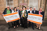 Lincoln Town Crier Karen Crow at Newark Castle Station along with stakeholders at the launch of the new Lincoln to Nottingham train timetable