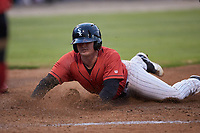 Tyler Osik (9) of the Kannapolis Intimidators slides across home plate during the game against the Hagerstown Suns at Kannapolis Intimidators Stadium on August 27, 2019 in Kannapolis, North Carolina. The Intimidators defeated the Suns 5-4. (Brian Westerholt/Four Seam Images)