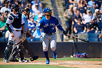Toronto Blue Jays center fielder Kevin Pillar (11) follows through on a swing in front of catcher Kyle Higashioka (66) and home plate umpire Dan Iassogna during a Grapefruit League Spring Training game against the New York Yankees on February 25, 2019 at George M. Steinbrenner Field in Tampa, Florida.  Yankees defeated the Blue Jays 3-0.  (Mike Janes/Four Seam Images)