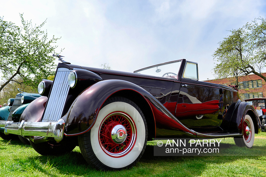 April 28, 2013 - Floral Park, New York, U.S. -  This Burgandy 1936 Packard 8 Victoria convertible, belonging to Jim Barnes of Bayside, is at the Antique Auto Show, where New York Antique Auto Club members exhibited their cars on the farmhouse grounds of Queens County Farm Museum.