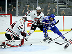 SIOUX FALLS, SD - MARCH 23: Evan Giesler #15 from Air Force buses to get the puck past goalie Dávid Hrenák #34 as teammate Jimmy Schuldt #22 defends from St. Cloud State University during their game at the 2018 West Region Men's NCAA DI Hockey Tournament at the Denny Sanford Premier Center in Sioux Falls, SD. (Photo by Dave Eggen/Inertia)