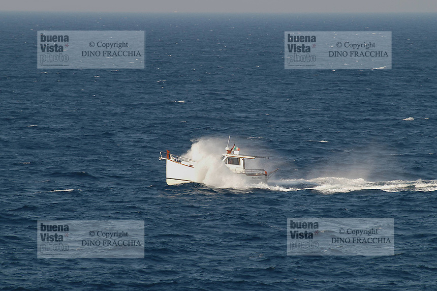 - Puglia, Otranto, small boat in navigation with agitated sea<br /> <br /> - Apulia, Otranto, piccolo battello in navigazione con mare agitato