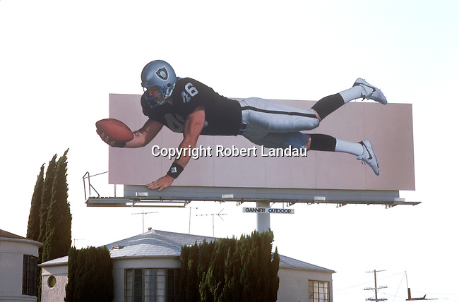 Nike billboard depicting a Raider football player catching a ball over a rooftop in Los Angeles, CA