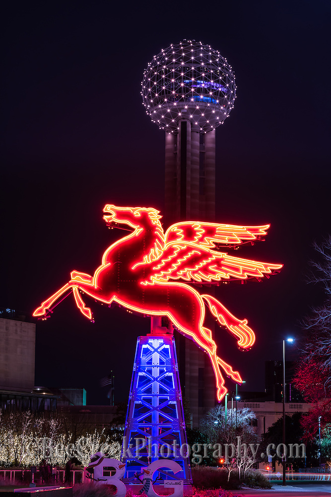 We captured these are two iconic landmark features of Dallas the Reunion Tower and the flying red Pegasus on top of a oil derick. This Pegasus had been on top of the Magnolia Hotel for more than half of a century taken after dark.  It was damage and was taken down and now stand in front of the Omni Hotel in downtown Dallas.