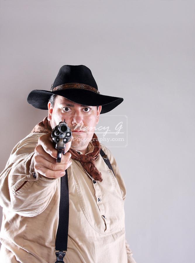 A cowboy pointing a gun
