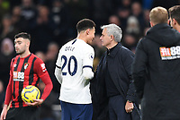 30th November 2019; Tottenham Hotspur Stadium, London, England; English Premier League Football, Tottenham Hotspur versus AFC Bournemouth; Jose Mourinho shares a joke with Dele Alli of Tottenham Hotspur on his substitution  - Strictly Editorial Use Only. No use with unauthorized audio, video, data, fixture lists, club/league logos or 'live' services. Online in-match use limited to 120 images, no video emulation. No use in betting, games or single club/league/player publications