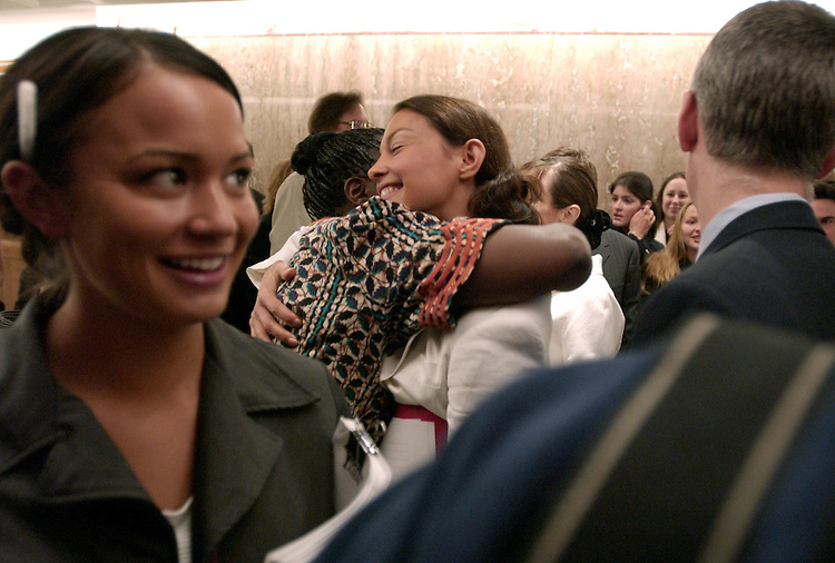 Actress Ashley Judd, right, hugs Dr. Pauline Muchina, after Judd testified before a Senate Foreign Relations Committee hearing, Thursday, which looked at the future of HIV/AIDS and an the initiative to develop an AIDS vaccine.  Judd is the global ambassador for Youth AIDS.