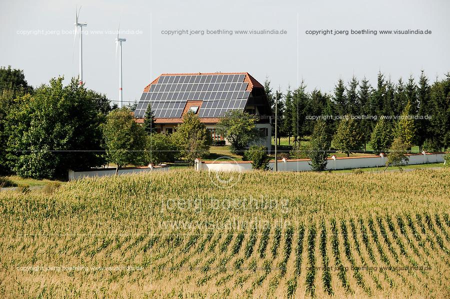 GERMANY, village with wind energy, house with solar panel, maize field / DEUTSCHLAND, Sachsen-Anhalt, Haus mit Solar Dach und Windkraftanlagen , Maisfeld