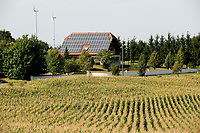 GERMANY, village with wind energy, house with solar panel, maize field / DEUTSCHLAND, Sachsen-Anhalt, Haus mit Solar Dach und Windkraftanlagen , Maisfeld