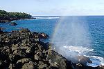 Taveuni, Fiji; ocean water sprays out of the Southern Blowhole, which creates rainbows in the sunlight