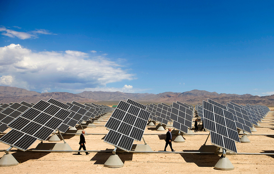 Secret Service agents follow President Barack Obama as he tours solar panels at Nellis Air Force Base in Las Vegas, Nevada.   Nellis has the  largest solar installation in the entire Western Hemisphere.   More than 72,000 solar panels provide 25 percent of the electricity for the 12,000 people who live and work at Nellis...Photo by Brooks Kraft/Corbis.......