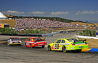 Jun. 21, 2009; Sonoma, CA, USA; NASCAR Sprint Cup Series driver David Reutimann (00) leads Kasey Kahne (9) and Paul Menard (98) through turn four during the SaveMart 350 at Infineon Raceway. Mandatory Credit: Mark J. Rebilas-