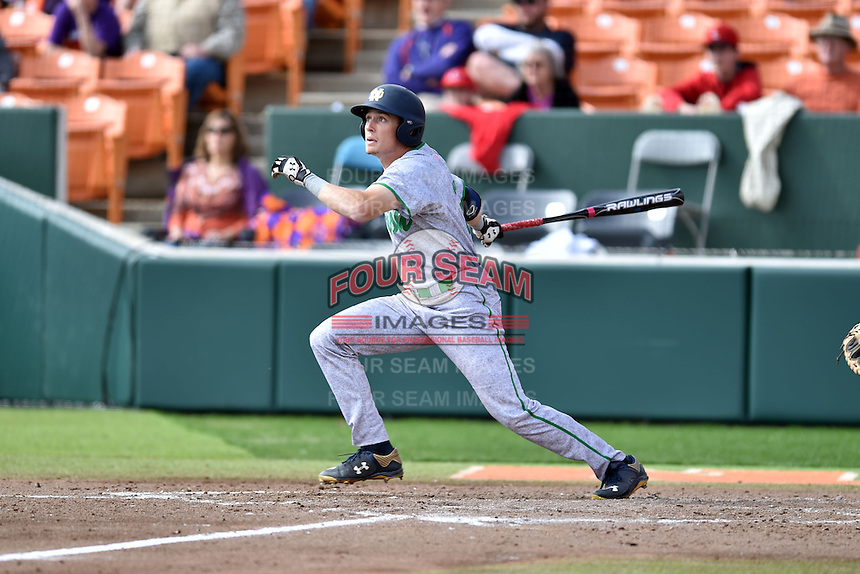 Notre Dame Fighting Irish right fielder Robert Youngdahl (25) swings at a pitch during a game against the Clemson Tigers during game one of a double headers at Doug Kingsmore Stadium March 14, 2015 in Clemson, South Carolina. The Tigers defeated the Fighting Irish 6-1. (Tony Farlow/Four Seam Images)